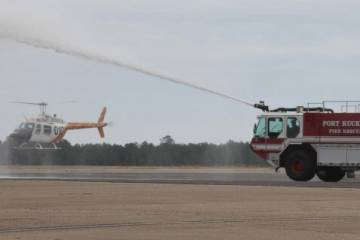 U.S. Army TH-67 receiving water cannon salute